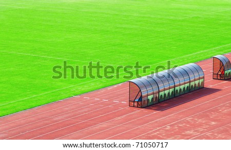 Coach and reserve bench near the field - stock photo