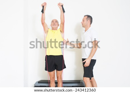 Coach helps senior with exercise