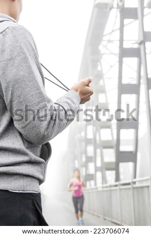 coach takes the time to stopwatch - stock photo