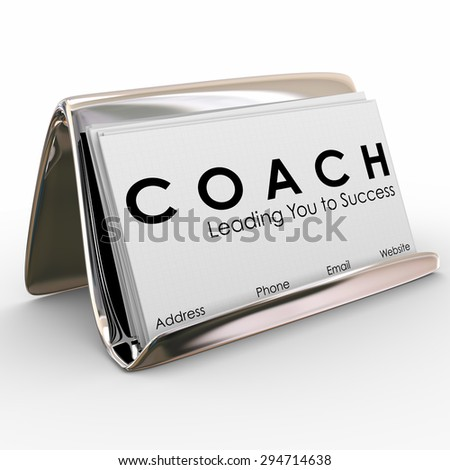 Coach word and Leading you to Success on a business card to advertise or promote your services as a leader, motivator, trainer, mentor or instructor for a team of athletes or business people - stock photo