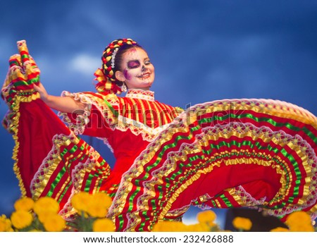 COACHELLA , CALIFORNIA - NOV 01 : Traditional Mexican dancer perform at the Dia De Los Muertos celebration in Coachella , California on November 01 2014 - stock photo