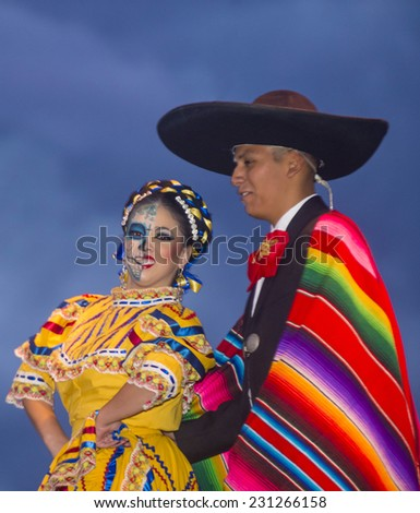 COACHELLA , CALIFORNIA - NOV 01 : Traditional Mexican dancers perform at the Dia De Los Muertos celebration in Coachella , California on November 01 2014 - stock photo