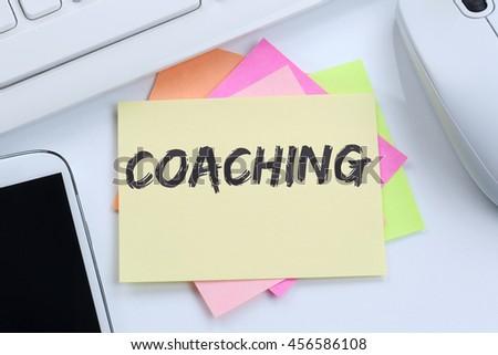 Coaching and mentoring education training workshop learning seminar desk computer keyboard - stock photo