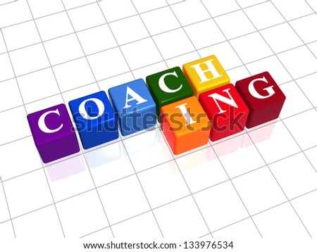 coaching text - white letters on 3d different colors cubes rainbow arranged, business concept - stock photo