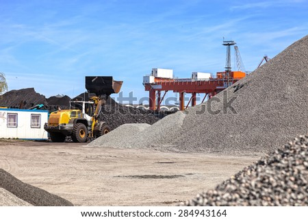 Coal and piles of stones yard storage.  - stock photo
