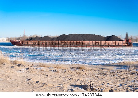 Coal barge - stock photo