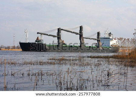 Coal cargo ship on river - stock photo