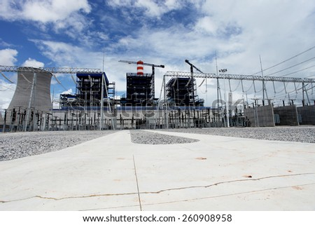 Coal fire Lignite power plant and 500 kV switchgear under-construction. - stock photo