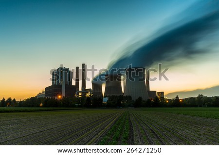 Coal-fired power plant at sunset - stock photo