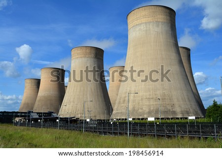 Coal fired power station cooling towers against summer sky - stock photo