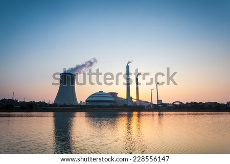 coal fired power station in sunset , industrial landscape