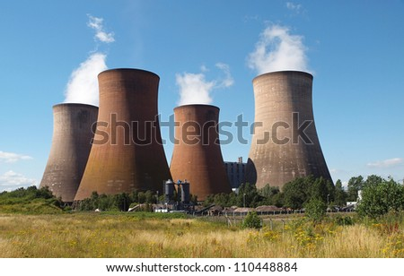 coal fired power station with cooling towers releasing steam into atmosphere - stock photo