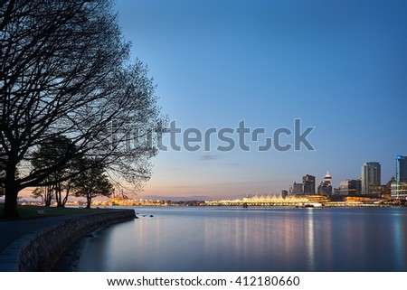 Coal Harbor Dawn, Vancouver. Downtown Vancouver seen from Stanley Park at dawn. Vancouver, British Columbia, Canada.  - stock photo
