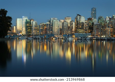 Coal Harbor, Evening Twilight, Vancouver. Downtown Vancouver skyline at sunset looking across Coal Harbor from Stanley Park, British Columbia, Canada.  - stock photo