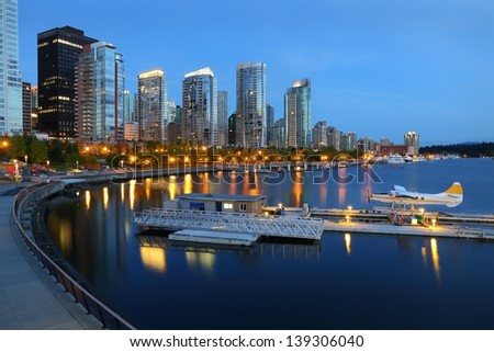 Coal Harbor Morning, Vancouver. Condominiums at twilight reflecting in the calm water of Coal Harbor in downtown Vancouver. British Columbia, Canada. - stock photo