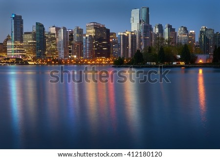 Coal Harbor Towers Twilight. Downtown Vancouver seen from Stanley Park at morning twilight. Vancouver, British Columbia, Canada.                                 - stock photo