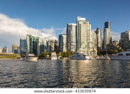 Coal Harbour viewed from the water on a cloudy evening. Picture taken in Downtown Vancouver, BC, Canada.