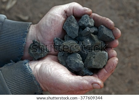 coal in the hands of the working - stock photo