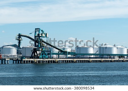 Coal loading belt with crane with bunkers - stock photo