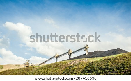 Coal mine infrastructure among beautiful mountains, USA - stock photo