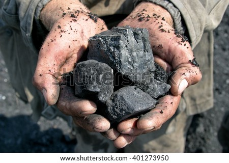 coal miner in the hands of - stock photo
