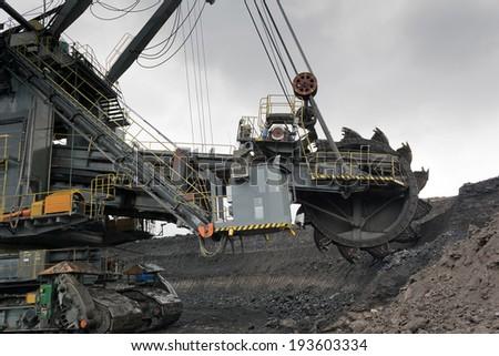 Coal mining in rainy day - stock photo
