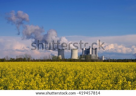 coal power plant and yellow rape field