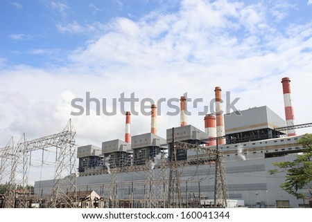 Coal Power Plant, Lignite coal fire power plant and switchyards. - stock photo