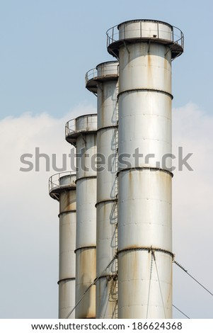 Coal Power Plant Towers Against Blue Sky - stock photo