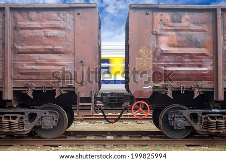 Coal railroad cars and speed train in motion - stock photo