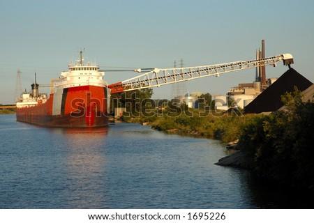 Coal ship off-loading - stock photo
