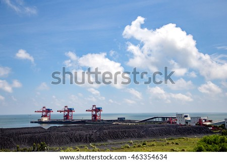 Coal terminal in the sea blue sky white cloud background