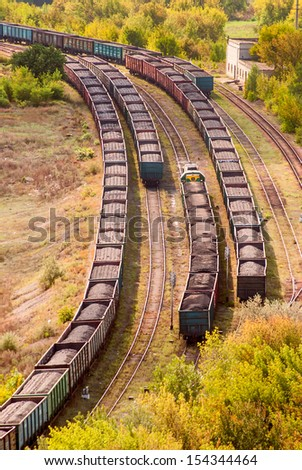 Coal train on railway tracks - stock photo