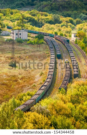 Coal trains on railway tracks on a station - stock photo