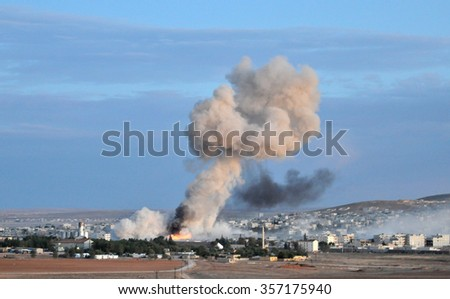 Coalition forces hitting to ISIS target in Kobani discirt in Syria, 22 October 2014, Suruc, Turkey. - stock photo