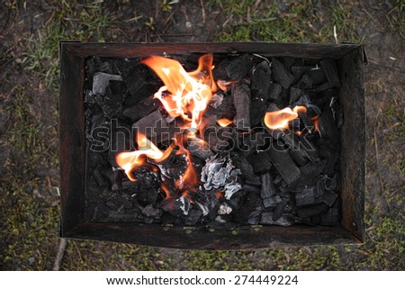 coals in the grill and burning flames fire - stock photo