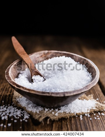 Coarse Salt (selective focus; close-up shot) on a dark vintage background - stock photo