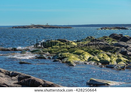 Coasstal scene over the baltic sea from the shore of Grisslehamn in Sweden - stock photo