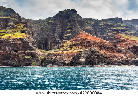 Coast and caves by the Awa'awapuhi Valley, Kauai, Hawaii - stock photo