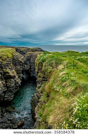 Coast at Hook Head near Waterford in Ireland - stock photo