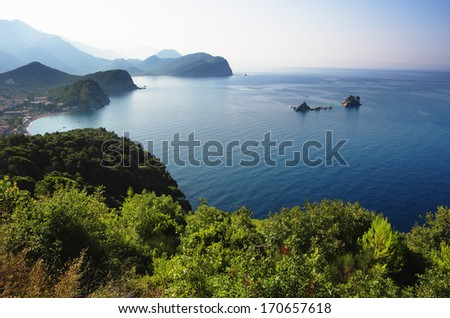coast between Budva and Bar, Montenegro. In the bay are two islets called Katic and Sveta Nedjelja - stock photo