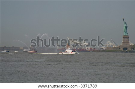 Coast Guard boat and fire tug in New York Harbor on May 23, 2007 during Fleet Week - stock photo