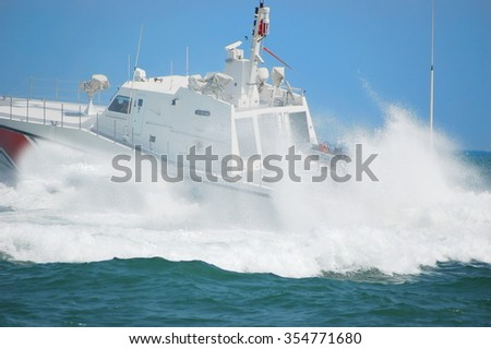 coast guard during storm in sea - stock photo