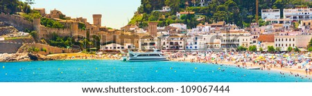 Coast line with  people under the sun (Panorama of Costa Brava, Tossa de Mar city, Spain) - stock photo
