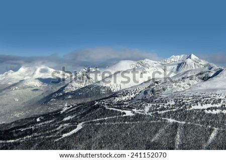 Coast Mountains with Armchair Glacier, Mt. Weart and Mt. Curie by Whistler - stock photo