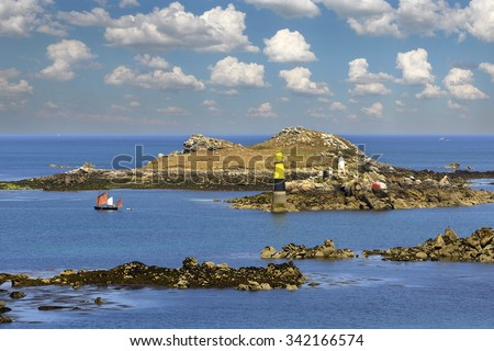 Coast near the town Roscoff. Roscoff (Breton: Rosko) is a commune in the Finistere departement of Brittany in northwestern France. - stock photo