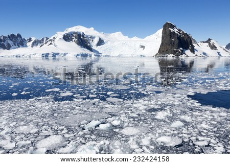 Coast of Antarctica. Centuries-old thicknesses of glaciers. Icebergs of unusual forms. Research of a phenomenon of global warming.