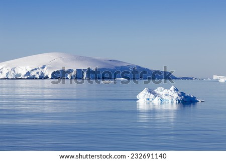 Coast of Antarctica. Centuries-old thicknesses of glaciers. Icebergs of unusual forms. Research of a phenomenon of global warming.  - stock photo