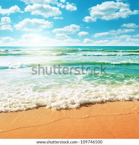 Coast of beach at sunny day. - stock photo