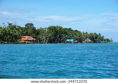 Coast of Carenero island with waterfront restaurant, Caribbean, Bocas del Toro, Panama, central America - stock photo